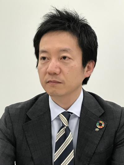 野村證券_写真(佐藤氏).jpg